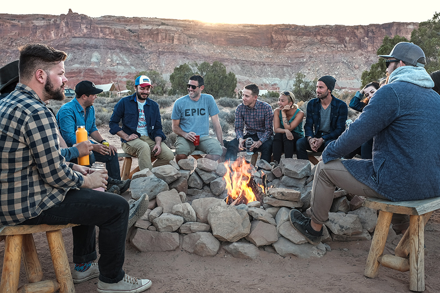 Financial Freedom - group of people around a campfire at sunset